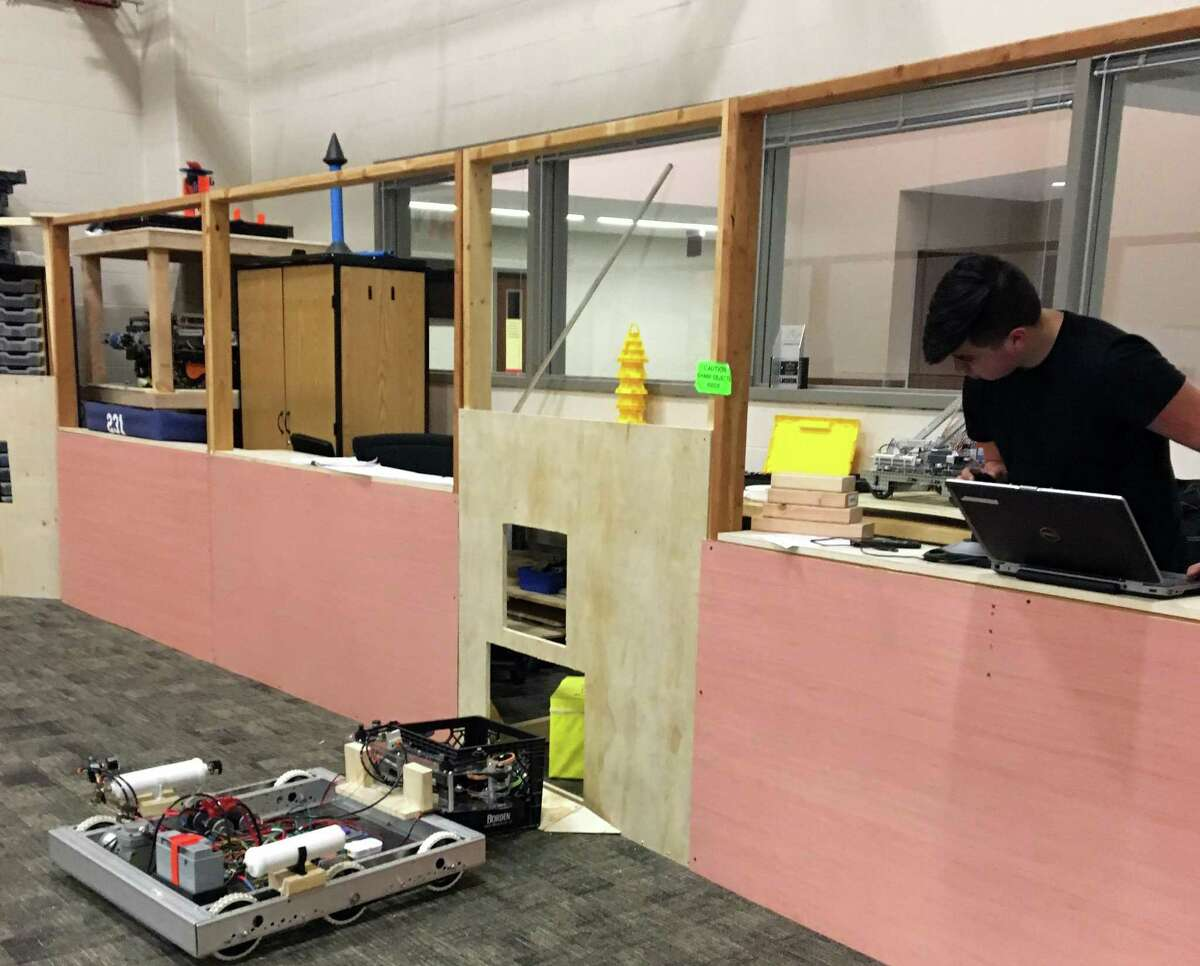 A student at the Pasadena Independent School District'sCareer and Technical Center drives a robot prototypeas a member of the district's FIRST Robotics Team High Voltage. The worldwide competition involves 3,400 teams, and the global championship will be held in Houston.