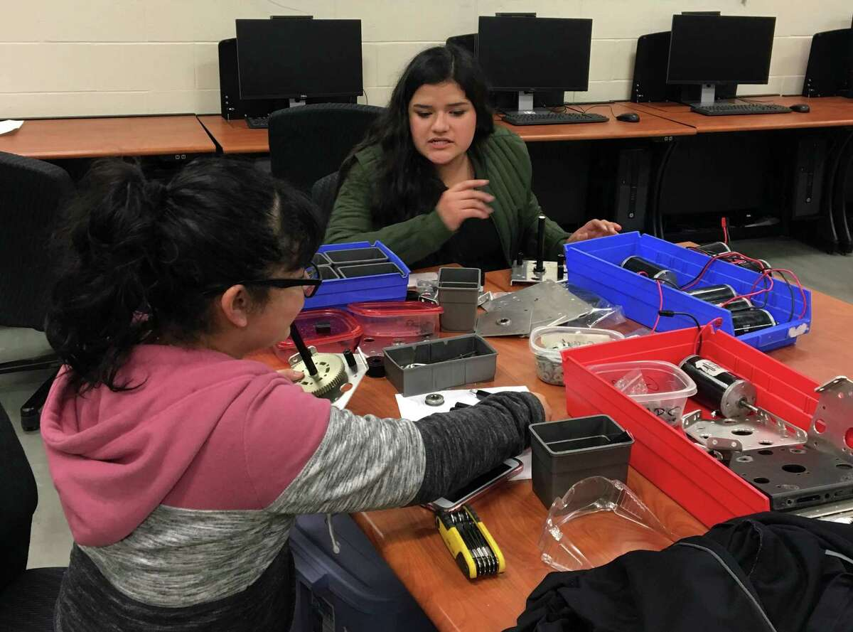 Joana Anaya, a 17-year-old junior in the Pasadena Independent School District assembles a gearbox for a robot as a member of the district's FIRST Robotics Team High Voltage. The worldwide competition involves 3,400 teams, and the global championship will be held in Houston.