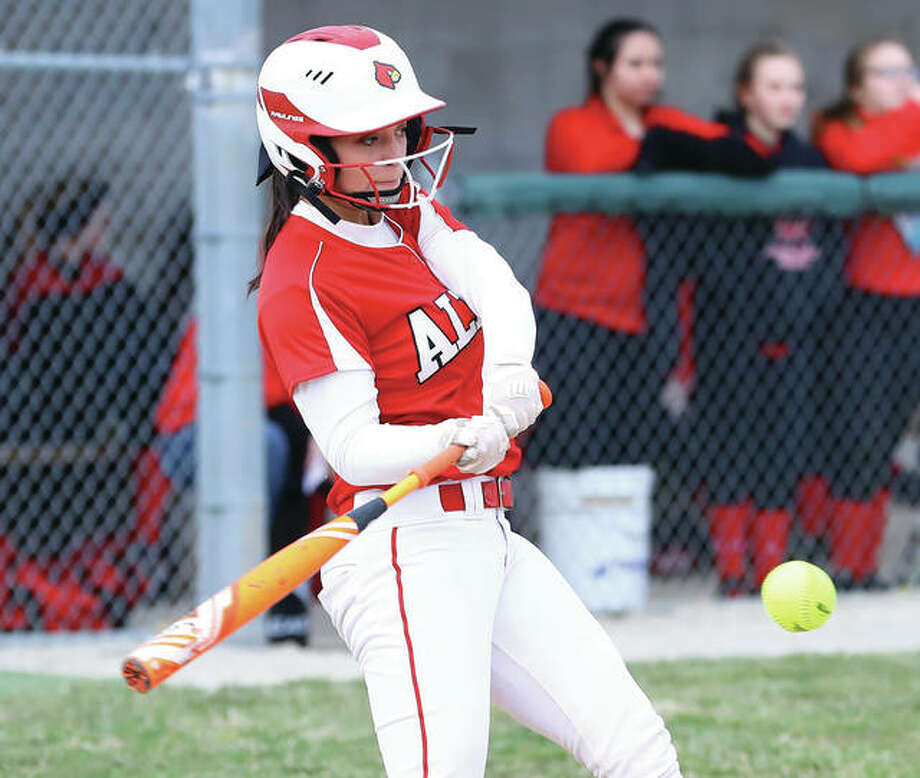 Alton's Miranda Hudson, shown hitting a double in a game against Bunker Hill last season at Alton High in Godfrey, returns for her senior season after hitting .343 with 36 RBIs and six home runs as a junior. Photo: Billy Hurst / For The Telegraph