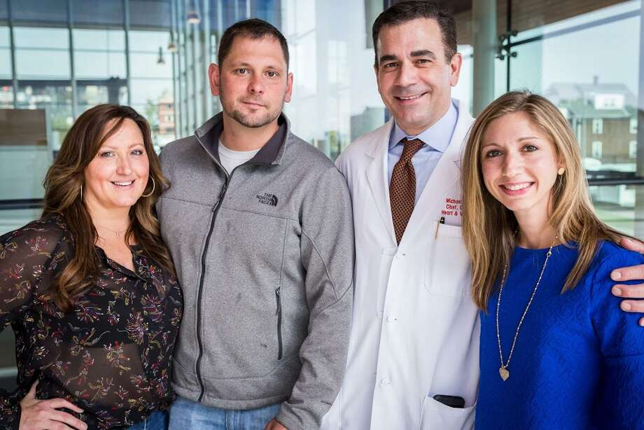 Andrea Rogers, Tim Scaggs, Dr. Michael Coady and Rachel Kornfeld stand for a photo at Stamford Hospital. Rogers, Scaggs and Kornfeld all underwent open-heart surgeries in the past year and, with Dr. Coady's help, have since become freinds. Photo: /