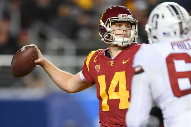 SANTA CLARA, CA - DECEMBER 01:  Sam Darnold #14 of the USC Trojans looks to throw a pass against the Stanford Cardinal during the Pac-12 Football Championship Game at Levi's Stadium on December 1, 2017 in Santa Clara, California.  (Photo by Thearon W. Henderson/Getty Images)