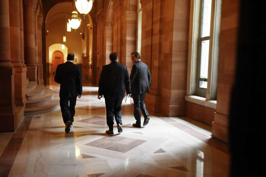 Senate Majority Leader John Flanagan, right, leaves the Hall of Governors after meeting with Gov. Andrew Cuomo for budget talks on Friday, March 30, 2018, at the Capitol in Albany, N.Y. (Will Waldron/Times Union)