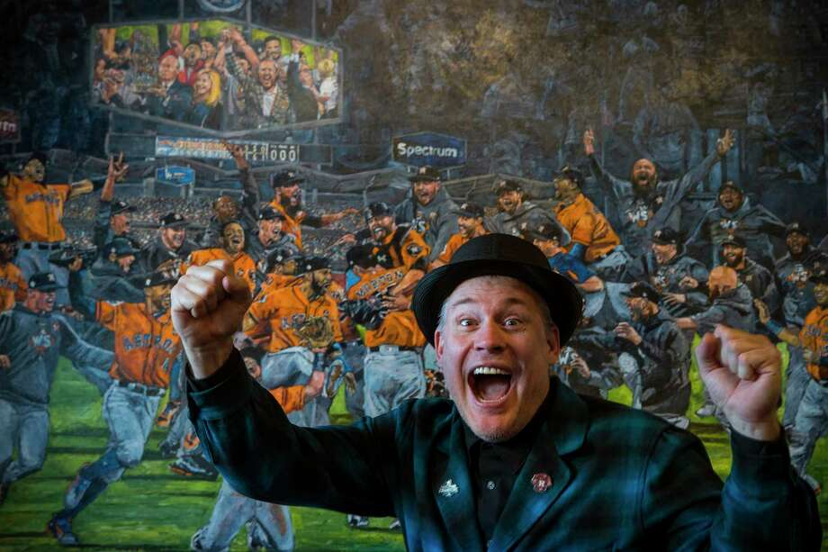 """Opie Otterstad poses for a portrait with his paintings at Off The Wall Gallery on Thursday, March 29, 2018, in Houston. Otterstad, a Houstonian who grew up with the Astros and has been an officially sanctioned artist for Major League Baseball for many years, made his largest """"celebration painting"""" yet to commemorate the 2017 World Series champions. Photo: Brett Coomer, Houston Chronicle / © 2018 Houston Chronicle"""