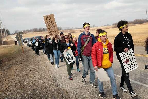 JANESVILLE, WI - MARCH 28:  Students march the last leg of a 50-mile journey into the hometown of House Speaker Paul Ryan (R-WI) to call attention to gun violence on March 28, 2018 in Janesville, Wisconsin. About 40 students from around Wisconsin organized the march, dubbed 50 Miles More, to keep alive the spirit and dialog of the recent March For Our Lives events.  (Photo by Scott Olson/Getty Images)