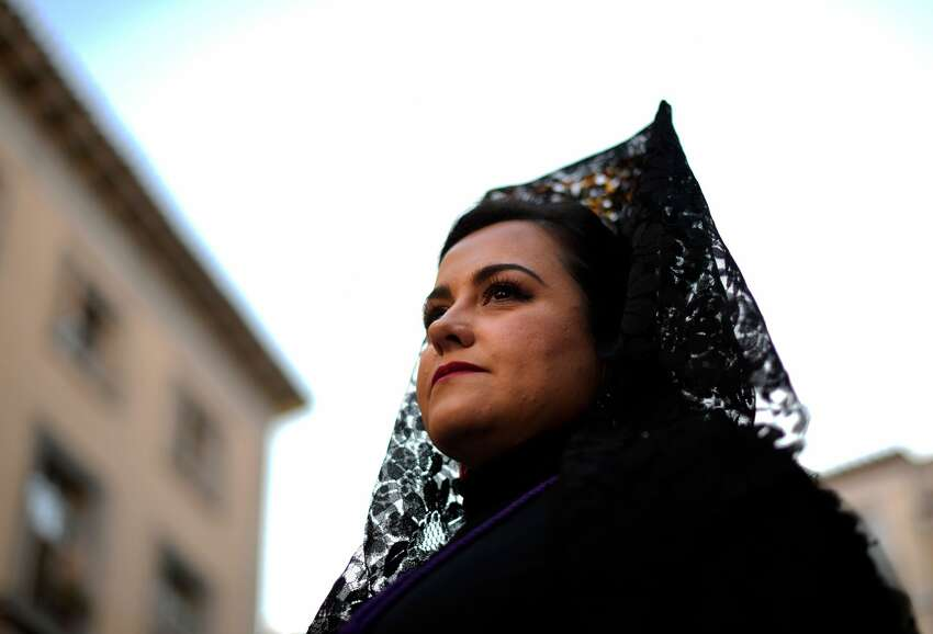A penitent sporting the traditional Spanish 'mantilla' (shawl) takes part in the