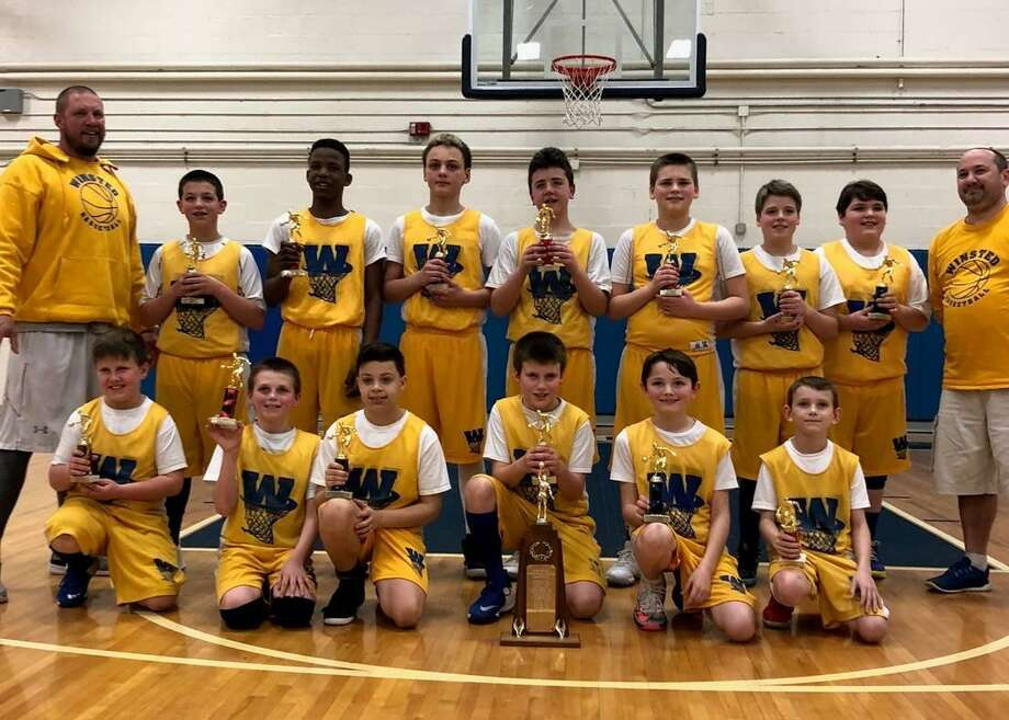 The Winsted youth basketball teams had an exciting weekend, March 10-11, winning three championships for the town. Pictured is the boys team, grades 5-6, with their trophies. Bottom row, from left, are Tyler, Aidan, Robbie, Zack, Gavin, Richie; top ro, with Coach Rich Bunnel, are Randy, Ezra, Ethan, Nick, Justin, Colton and Coach Brandon Fields. Photo: Contributed Photo /Town Of Winsted