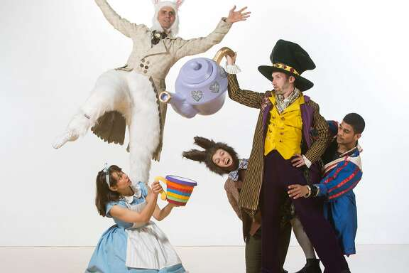"Dancers from Mark Foehringer's ""Alice in Wonderland,"" pictured left to right:  Sonja Dale (Alice), Raphael Boumaila (rabbit), Emily Hansel, Moses Kaplan (Mad Hatter), Raul Torres-Bonilla (in blue and red costume).  Photo: Matt Haber"