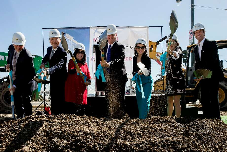 Officials with the hotel, architects' firms and city wield ceremonial shovels with other dignitaries at the groundbreaking for Marriott SoMa Mission Bay Hotel. Photo: Santiago Mejia / The Chronicle