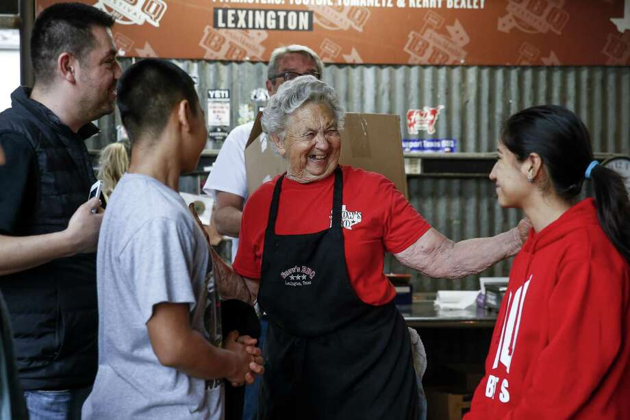 """Snow's BBQ 82-year-old pit master, Norma """"Tootsie"""" Tomanetz, second from right, laughs with Martin Nunez, left, Maximus Nunez, 12, second from left, and Valerie Nunez, 14, right, after they came from Chicago to try her bar-b-cue Saturday, March 24, 2018 in Lexington. (Michael Ciaglo / Houston Chronicle) Photo: Michael Ciaglo, Houston Chronicle / Houston Chronicle / Michael Ciaglo"""
