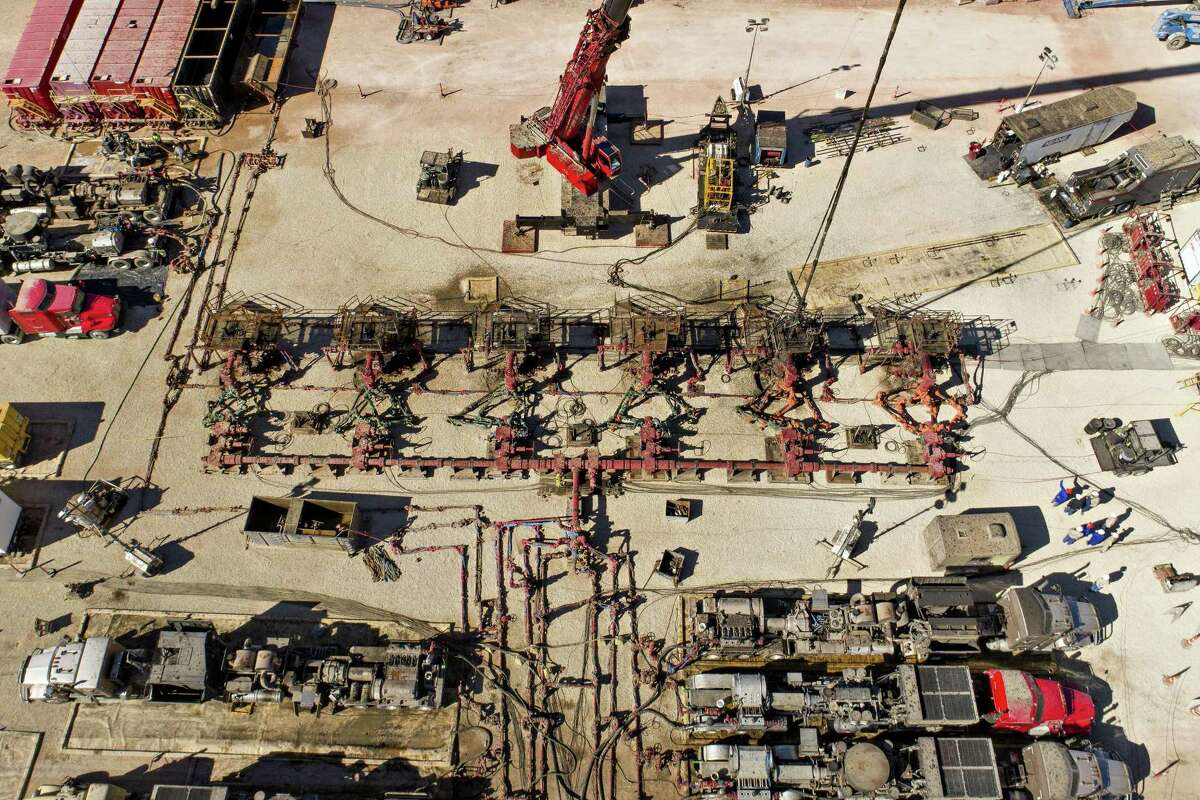 Pipes connect six Chevron Corp. oil wells being readied for hydraulic fracturing in the Permian Basin in this aerial photograph taken near Midland, Texas, U.S., on Thursday, March 1, 2018. The latest shale drilling boom is driving unemployment to the lowest levels in years in many of the areas that encompass the Permian Basin, a 17-county region that spans West Texas and eastern New Mexico, according to data compiled by the Permian Basin Regional Planning Commission, a cross-border coalition geared toward diversifying the region's economy.