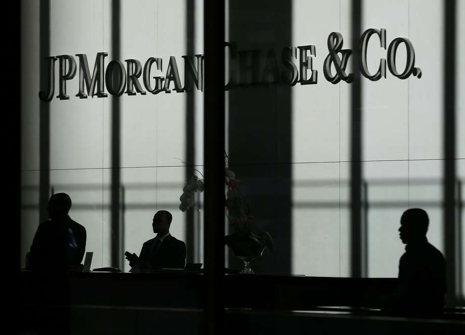 FILE - In this Monday, Oct. 21, 2013, file photo, the JPMorgan Chase & Co. logo is displayed at their headquarters in New York.  Photo: Seth Wenig, Associated Press