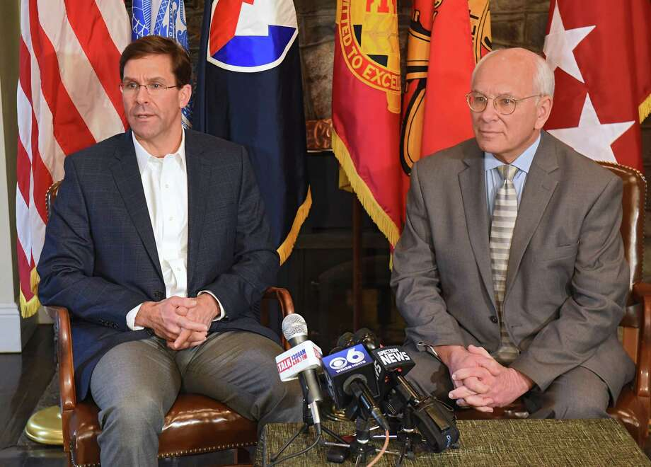 Dr. Mark T. Esper , the Secretary of the Army, left, and Congressman Paul Tonko talk to the press after taking a tour of the Watervliet Arsenal on Friday, March 30, 2018 in Watervliet, N.Y. (Lori Van Buren/Times Union) Photo: Lori Van Buren, Albany Times Union / 40043353A