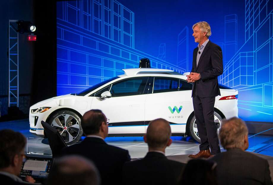 """John Krafcik, Waymo's CEO, onstage Tuesday in New York, where he announced a long-term partnership for a driverless-car project with Jaguar Land Rover. Krafcik envisions a self-driving service for """"millions of people across the country."""" Photo: Joshua Bright / New York Times"""