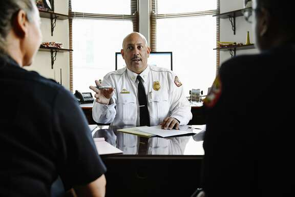 New Oakland Fire Department chief Darin White has a meeting with interim deputy chiefs Melinda Drayton and Erik Logon in his office in Oakland, CA, on Thursday November 30, 2017.