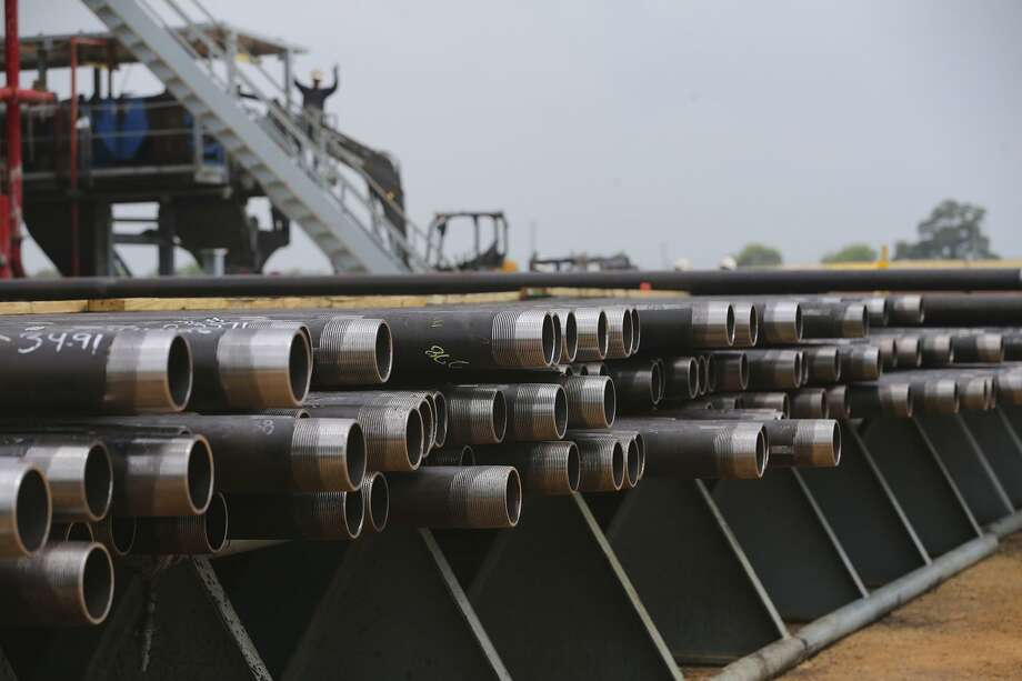 Drilling pipe is stacked neatly, ready to go down the hole Thursday May 12, 2017 at Abraxus Petroleum's Shut Eye Unit oil well. It is located south of San Antonio near Jourdanton, Texas. Photo: John Davenport /San Antonio Express-News / ©San Antonio Express-News/John Davenport