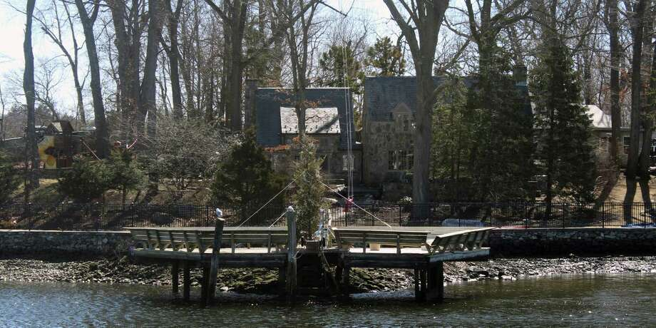 Although spring has arrived, a home across from Riverside Avenue in Westport still has a Christmas tree on its dock. Photo: Sophie Vaughan / Hearst Connecticut Media / Fairfield Citizen