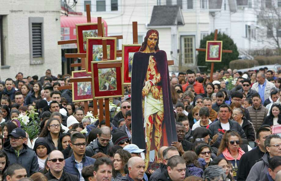 Parishioners from St. Mary's Church and St. Benedict-Our Lady of Montserrat participate in the annual Good Friday procession through the streets of Stamford's East Side on Friday. Photo: Matthew Brown / Hearst Connecticut Media / Stamford Advocate