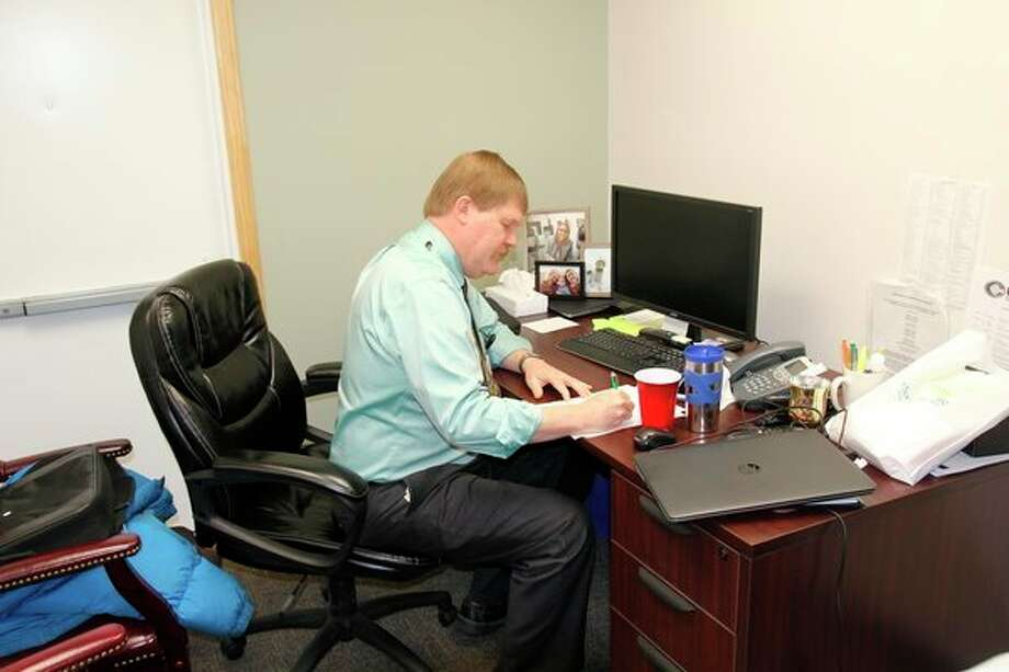 Dr. Robert Van Howe, the area's newest board certified pediatrician, works on paperwork at his office. Van Howe, who recently was hired by Hills and Dales General Hospital, will work out of Millwood Street Primary Care in Caro and Thumb Pediatrics in Cass City. (Mike Gallagher/Huron Daily Tribune)