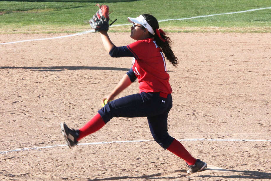 Plainview pitcher Trini Perez takes a big step as she fires a pitch toward home plate in a District 3-5A game against Palo Duro in Amarillo Thursday. Perez pitched two innings of one-hit ball and struck out four to help the Lady Bulldogs to an 18-0 win. Photo: Carmen Ortega/Plainview Herald