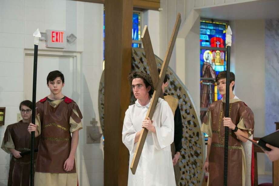 The St. Pius X Catholic Church Youth Peer Ministry performed the solemn living and traditional Stations of the Cross Good Friday at church on Westfield Street in Middletown. For Christians, the holy day marks when Christ died on the cross. Photo: Sandy Aldieri Photos