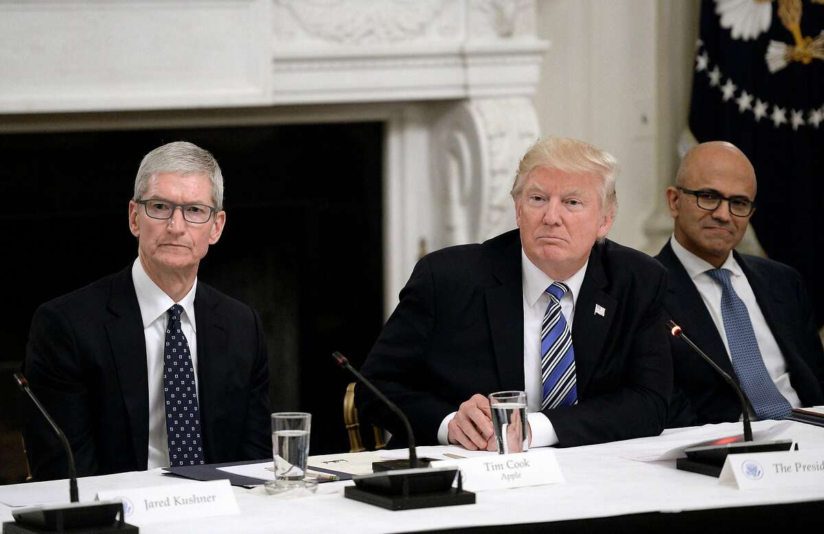 President Donald Trump, middle, welcomes members of his American Technology Council, including Apple CEO Tim Cook, left, and Microsoft CEO Satya Nadella on June 19, 2017, in the State Dining Room of the White House in Washington, D.C. (Olivier Douliery/Abaca Press/TNS)