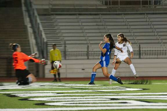 Friendswood's Katie Reyes (15) tries to block a shot by Pearland's Mckenzie Rizqi (2) which turns out to be the only goal scored and the winning goal against Friendswood Thursday, Mar. 29 at CCISD Challenger Stadium.