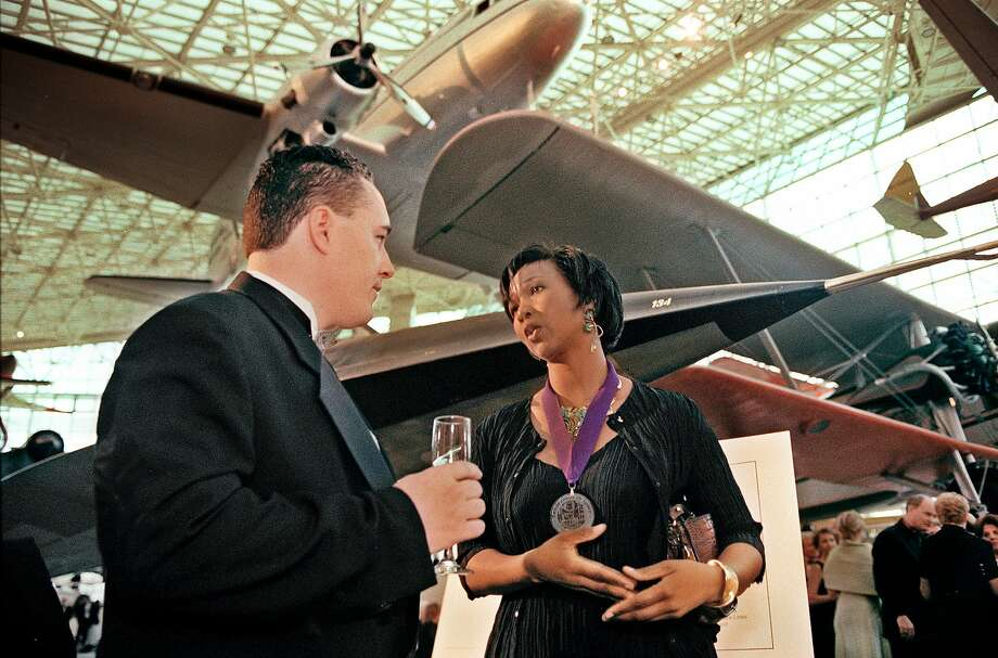 At a 2013 gala reception and dinner at the Museum of Flight in Seattle, astronaut Mae Jemison speaks with Jeff Pace about her experience aboard Space Shuttle Endeavor in 1992. Photo: Daniel Sheehan 2013