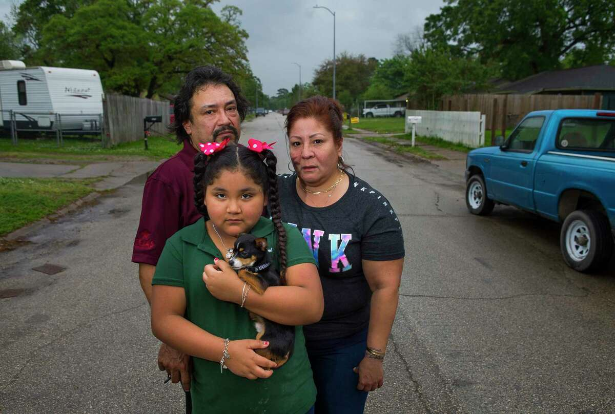 Fabian Hinojosa and Betty Cuellar and their granddaughter, Alex, 9, with her dog Sparky, recently moved back into their home on Talton Street in East Houston, Wednesday, March 28, 2018, in Houston. Betty's aunt, uncle and four nieces and nephews were among the victims of Harvey's flooding when the family, who lived in the neighborhood, had their van overtaken by floodwaters trying to leave the area. The neighborhood is not in a designated floodplain, but has suffered catastrophic flooding especially during Harvey and Tropical Storm Allison.