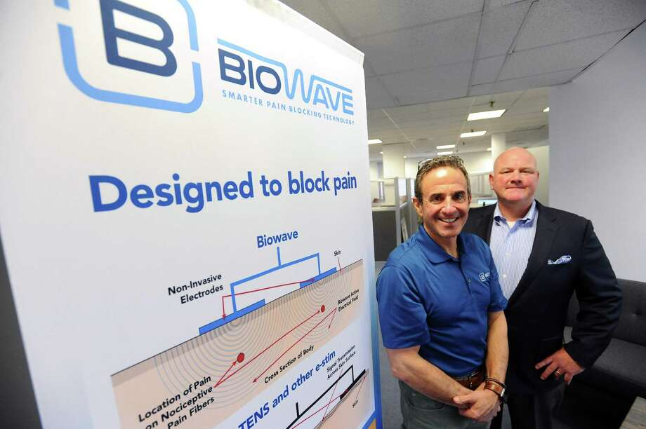 Biowave founder and president Bradford Siff, center, and CEO Rob Wolter pose for a photo inside their Knight St. office in Norwalk, Conn. on Thursday, March 29, 2018. Photo: Michael Cummo / Hearst Connecticut Media / Stamford Advocate