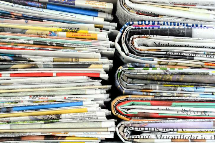 Stack of bundled newspapers.