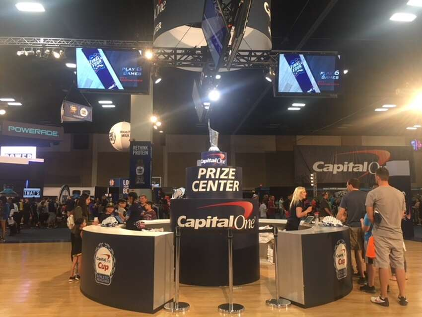 Capital One's Cup Challenge Prize Center Fan Fest guests check in at the Prize Center to receive a player card which will keep track of interactive game scores. The more Capital One-sponsored games a person plays, the more swag they will score.