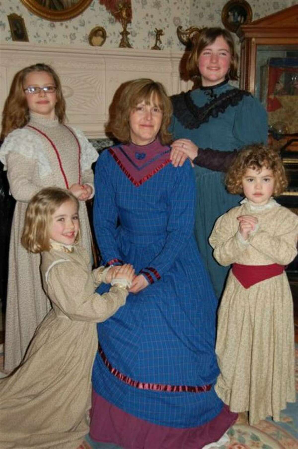 Laura Schonhiutt of Niskayuna, who died Dec. 7 after a long battle with breast cancer, is pictured with her four daughters. Clockwise from left are Rachel, Tori, Liz and Sarah. The family are in period dress at a Victorian tea party for Tori's 11th birthday earlier this year. (Photo provided by Dana Donohue)