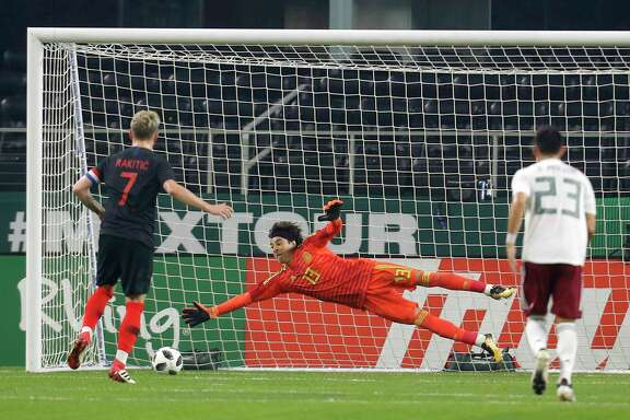 Croatia midfielder Ivan Rakitic (7) scores on a penalty kick against Mexico goalkeeper Guillermo Ochoa (13) as midfielder Jeséºs Molina (23) watches in the second half of a international friendly soccer match in Arlington, Texas, Tuesday, March 27, 2018. (AP Photo/Roger Steinman)