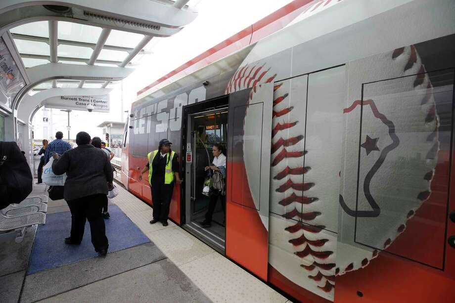 """A METRO train featuring a graphic wrap of  """"Houston Strong"""" and a baseball theme is shown during unveiling event at Burnett Transit Center on Oct.27. Photo: Melissa Phillip, Houston Chronicle / Houston Chronicle 2017"""