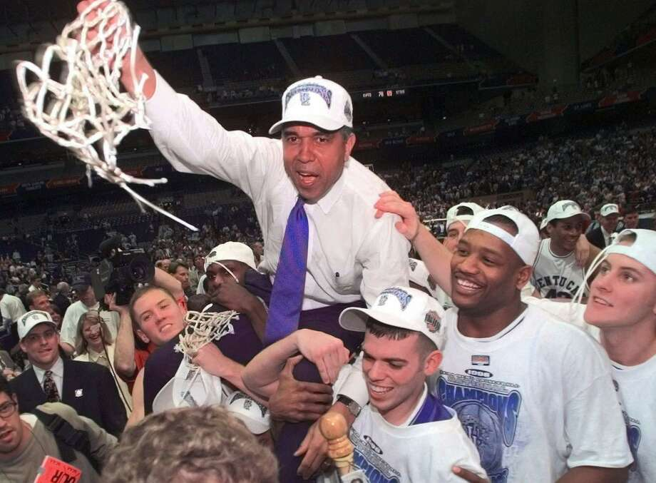 Kentucky Coach Tubby Smith is carried off the court by game MVP Jeff Sheppard, left, Steve Masiello, center right, and Myron Anthony, second right, at the Alamodome in San Antonio Monday, March 30, 1998. Other players, cheerleaders and fans surround. (AP Photo/Eric Draper) Photo: ERIC DRAPER, Staff / Associated Press / AP
