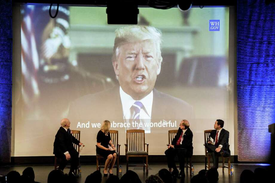 New citizens watch a video of President Donald Trump during a citizenship ceremony in New York, Sept. 18. The 2020 census will ask respondents if they are U.S. citizens, the Commerce Department announced March 27, 2018. Critics fear that the highly charged request by the Trump administration will result in a substantial undercount of the population because immigrants might not take part. Photo: DEVIN YALKIN /NYT / NYTNS