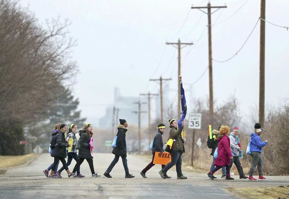 Students march toward Janesville, Wis., the hometown of Speaker of the House Paul Ryan, to call for stricter gun control laws.  Readers discuss gun violence and how to deal with it. Photo: Anthony Wahl /Associated Press / The Janesville Gazette