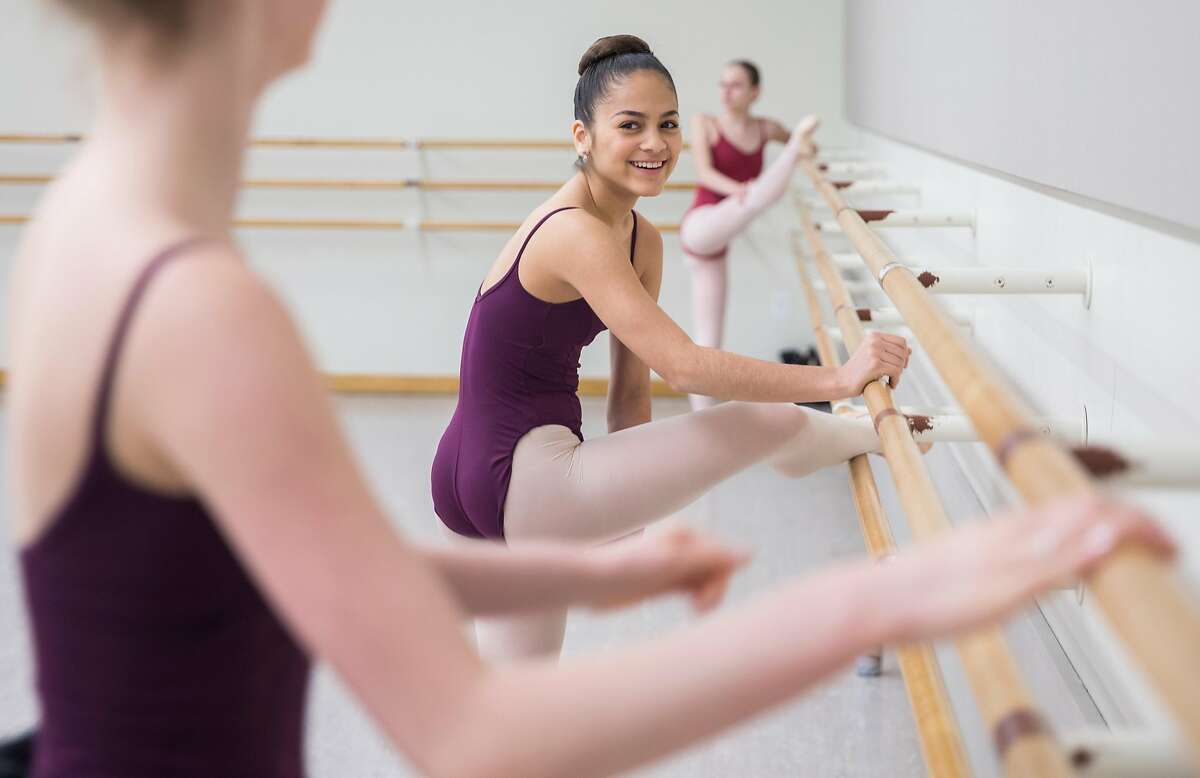 Iris Rocio Davila, 16, of Puerto Rico laughs with a classmate before participating in a skills class at the San Francisco Ballet School Wednesday, March 14, 2018 in San Francisco, Calif.