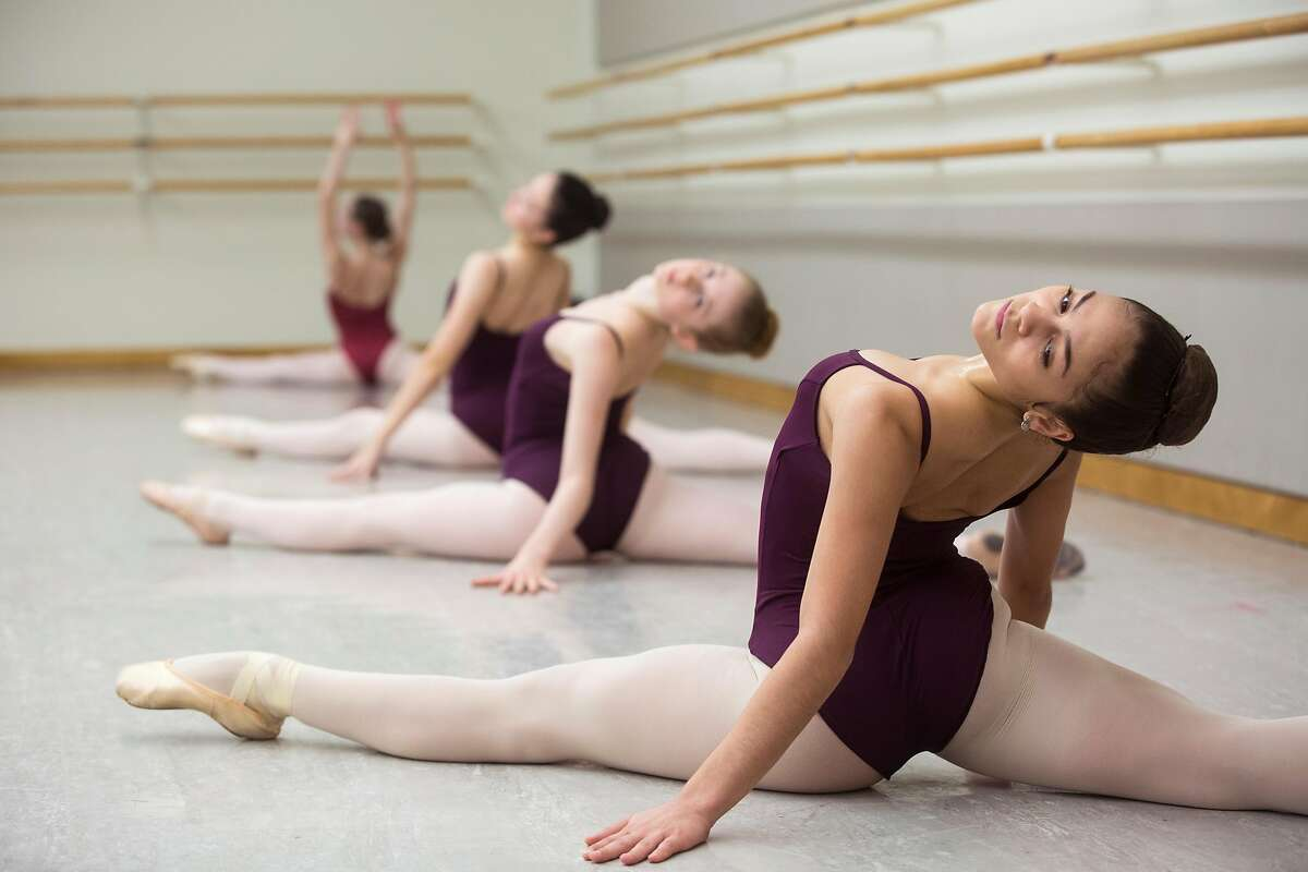 Iris Rocio Davila, 16, of Puerto Rico, right, participates in a skills class at the San Francisco Ballet School Wednesday, March 14, 2018 in San Francisco, Calif.