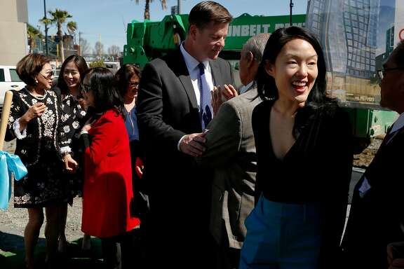 Anita Lee (in red), Mayor Mark Farrell (center) and Supervisor Jane Kim (right) at the site of construction for the Marriott SOMA Mission Bay Hotel, located at 100 Channel St., Thursday, March 29, 2018, in San Francisco, Calif.