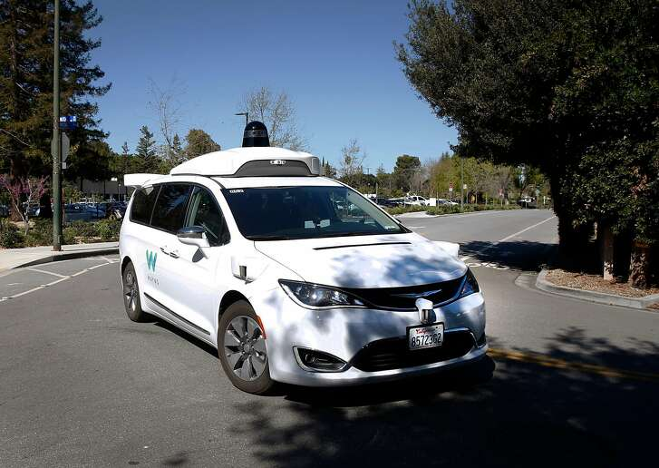 A Waymo self-driving car turns a corner in Mountain View, Calif. on Wednesday, March 28, 2018.