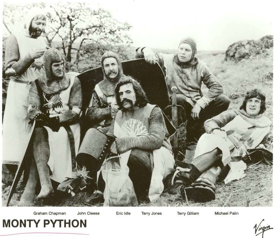 "BRITISH COMEDY TROUPE, ""MONTY PYTHON"". GRAHAM CHAPMAN, JOHN CLEESE, ERIC IDLE, TERRY JONES, TERRY GILLAM, MICHAEL PALIN.  from the set of the film  MONTY PYTHON AND THE HOLY GRAIL.  HOUCHRON CAPTION (01/16/2005) SECZEST: SETTING THE CINEMA BACK 900 YEARS: Graham Chapman, from left, John Cleese, Eric Idle, Terry Jones, Terry Gillam and Michael Palin on the set of the 1975 film Monty Python and the Holy Grail; 2. SPAM!: Hormel has created the limited-edition ""golden honey grail"" Spam flavor in honor of the musical Monty Python's Spamalot. Photo: VIRGIN / handout"