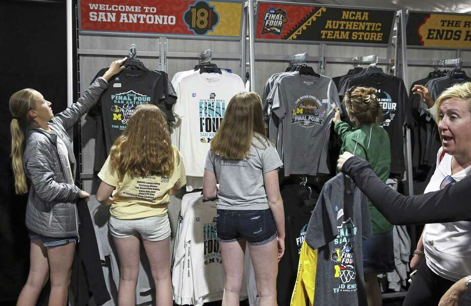 Final Four shirts are a hot item and NCAA official store good sell briskly during the Final Four Fan Fest at the Convention Center on March 30, 2018. Photo: Tom Reel, Staff / San Antonio Express-News / 2017 415916Z.1 ANTONIO EXPRESS-NEWS