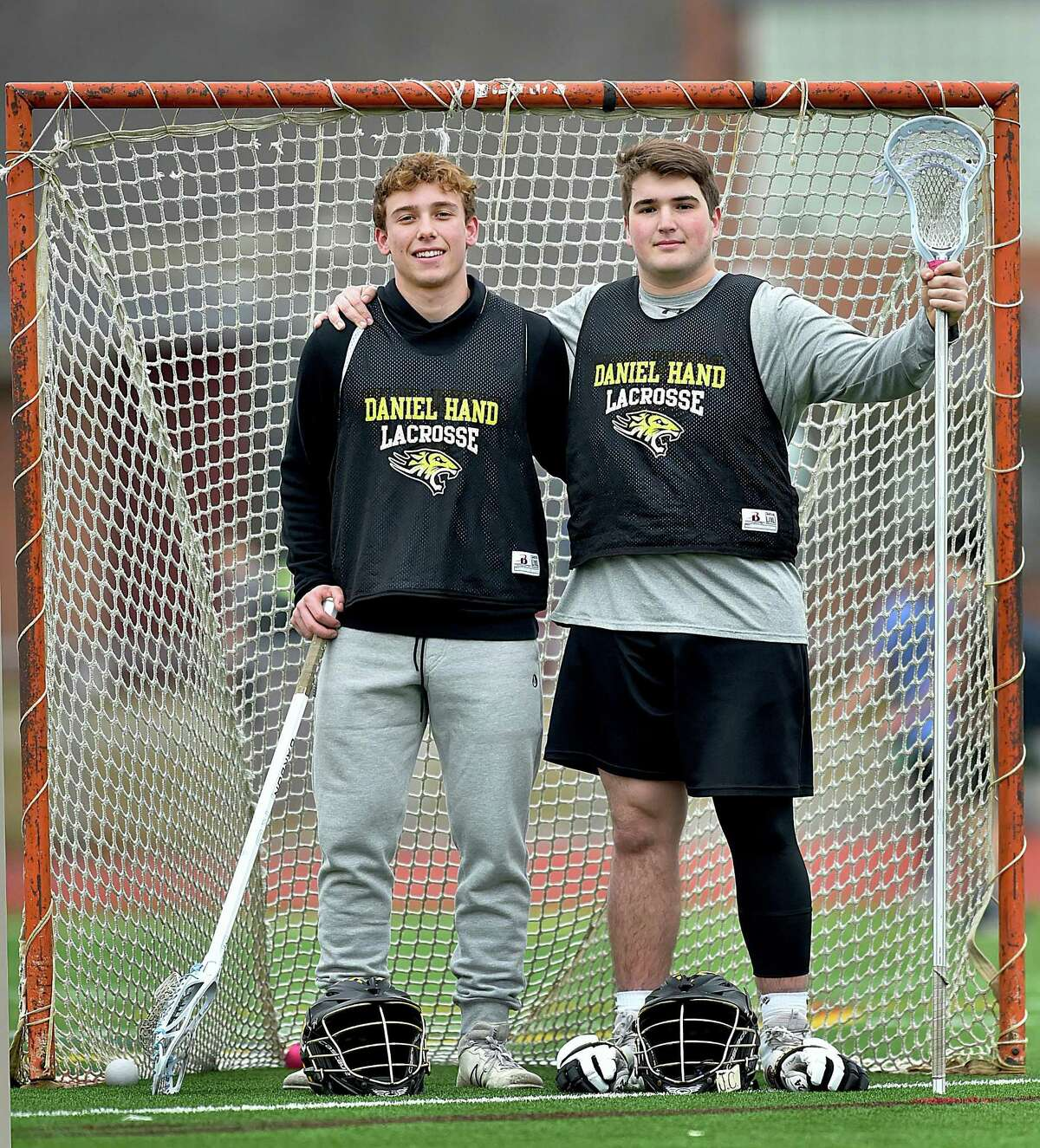 Hand lacrosse captains, attackman Nate Palumbo and defenseman Kevin Hughes.