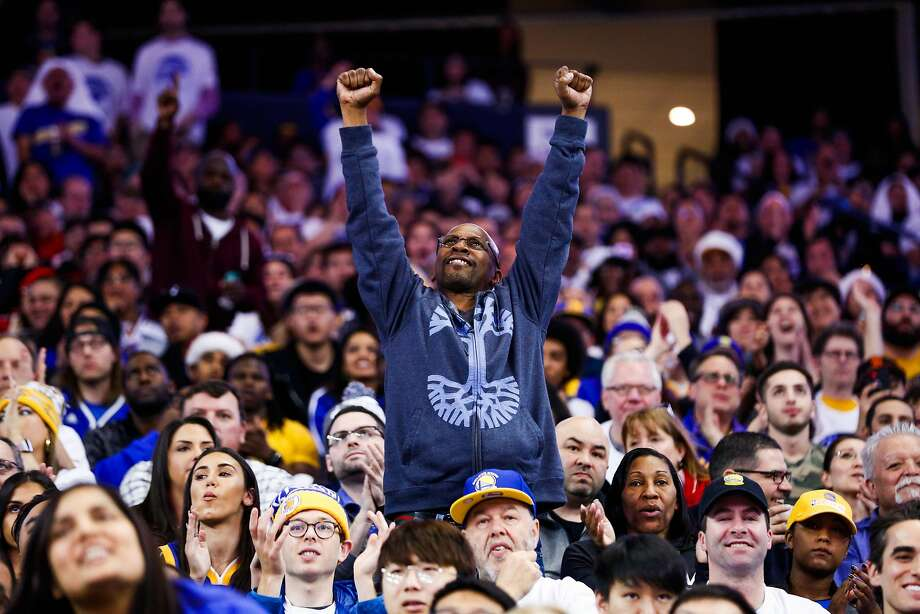 Rasta Talley cheers on the Warriors during their win over the Cleveland Cavaliers on Christmas Day —before injuries began to take their toll on the team. Photo: Gabrielle Lurie / The Chronicle