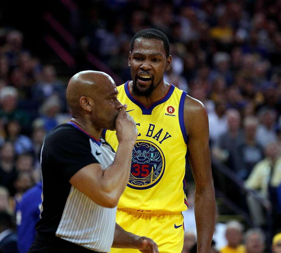 Kevin Durant of the Warriors argues with referee Tre Maddox, who ejected him from Thursday's game at Oracle Arena. The powerhouse Golden State Warriors suddenly look more meek than mighty. Photo: Carlos Avila Gonzalez, The Chronicle