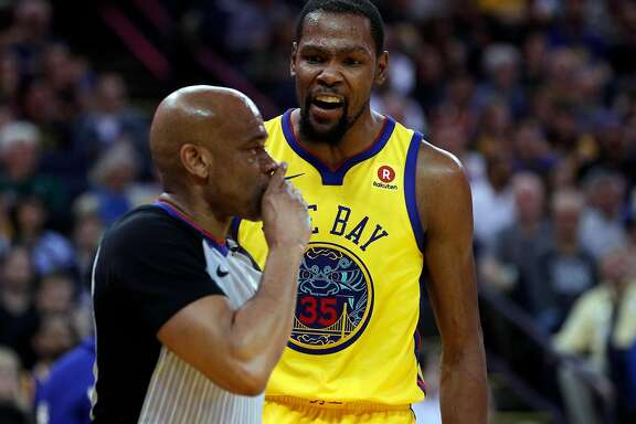 Kevin Durant (35) reacts after referee Tre Maddox (73) gives him a technical foul and ejected him in the first half as the Golden State Warriors played the Milwaukee Bucks at Oracle Arena in Oakland, Calif., on Thursday, March 29, 2018.