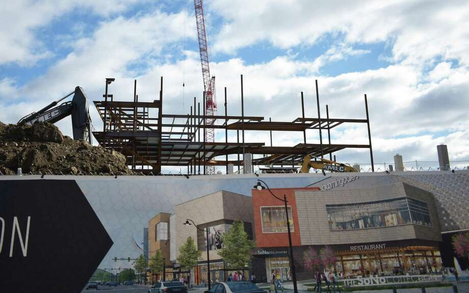 Girders for the SoNo Collection mall rise skyward on Jan. 24, 2018, at the construction site in South Norwalk, Conn. Photo: Alexander Soule / Hearst Connecticut Media / Stamford Advocate