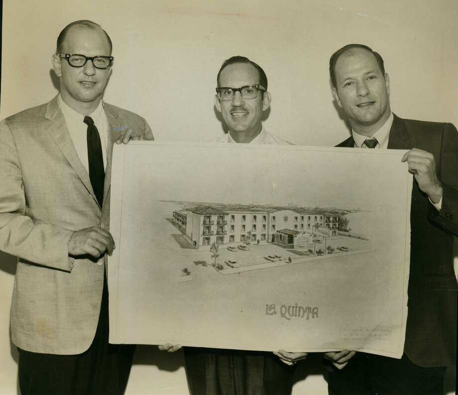 Sam Barshop (left), president of Barshop Motel Enterprises, and his brother Philip (right), vice president, unveil plans to build a La Quinta Motor Inn in downtown San Antonio in June 1967 for HemisFair '68. Between them is Robert S. Noyes. Photo: File Photo /San Antonio Express-News
