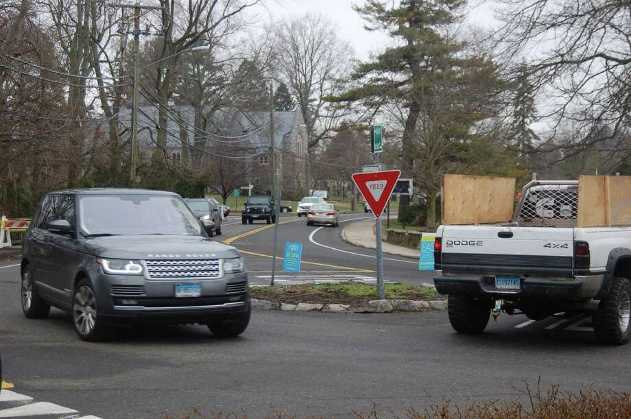The heavily used traffic circle on Sound Beach Avenue in Old Greenwich is slated to be turned into more of a traditional roundabout as part of a project to replace a bridge there and raise the level of the road. Neighbors have protested though and the project will be discussed by the Planning and Zoning Commission on Tuesday. Photo: Ken Borsuk